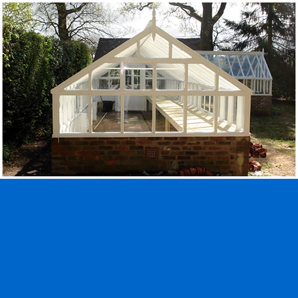 Photo of end of Softwood Timber Framed greenhouse in Ockley.