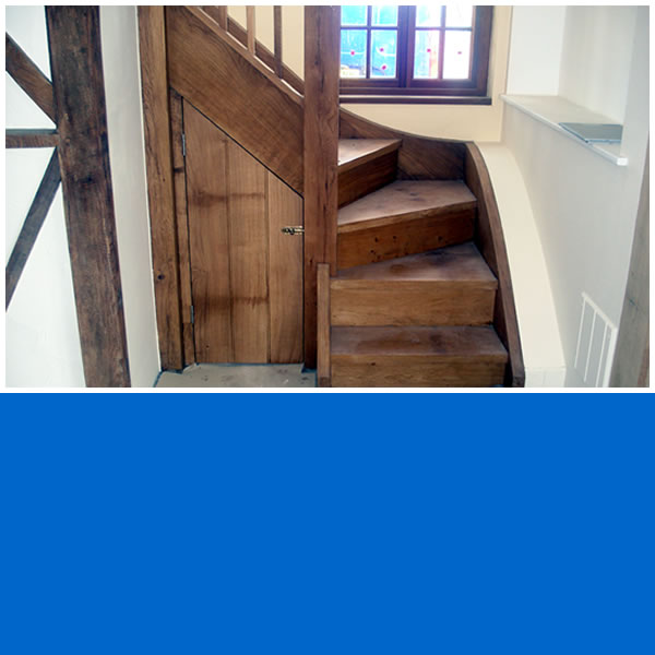 Staircase and storage area photo.