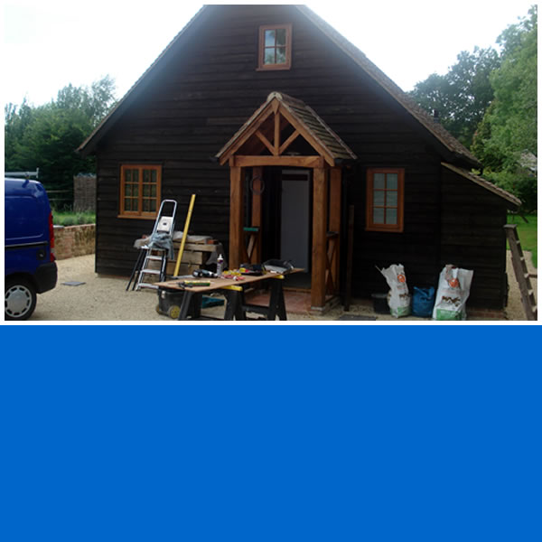 Photo of 'Little House' timber frame building.